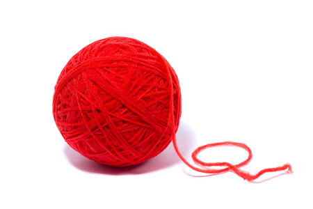 Foto de red ball of yarn for knitting, isolate, homemade crafts - Imagen libre de derechos