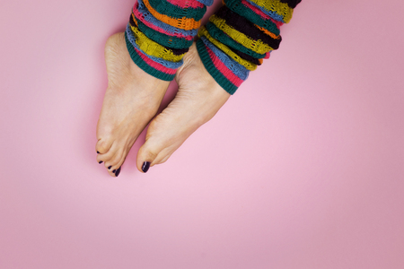 Foto de Female feet in socks on a pink background - Imagen libre de derechos