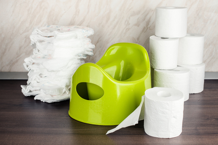 Foto für children's toilet pot green, nappies and toilet paper, the concept of the baby's transition from diapers to the toilet - Lizenzfreies Bild