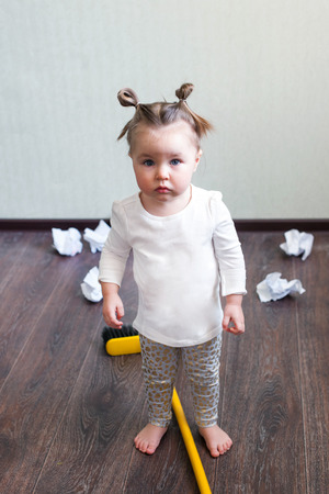 Photo for a girl holds a broom for 1.5 years, the concept of house cleaning, cleaning company, cleaning space, minimalism - Royalty Free Image