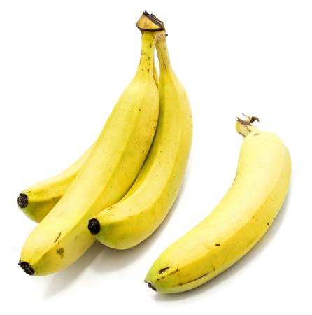 Foto de Group of yellow whole bananas isolated on white background  - Imagen libre de derechos