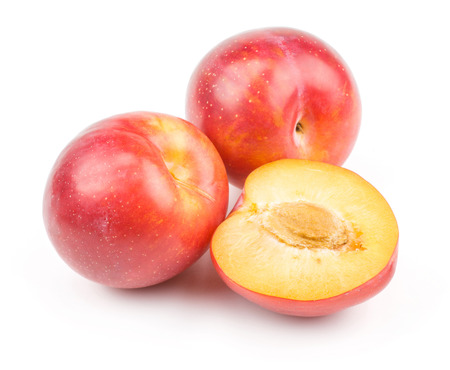 Photo pour Plums red orange two whole one half isolated on white background fresh and glossy  - image libre de droit