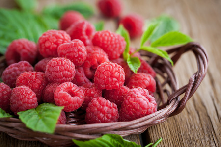 Photo for Fresh organic ripe raspberry with leaf in basket,  selective focus - Royalty Free Image