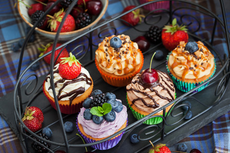 Photo for Set of different delicious cupcakes on dark - Royalty Free Image