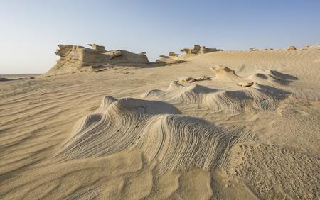 sand formations in a desert near Abu Dhabi, UAE