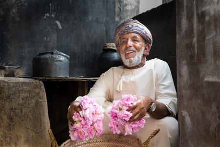 Photo for JABAL AL AKHDAR, OMAN - CIRCA APRIL 2016: three Omani man holding rose petals, to make rose water - Royalty Free Image