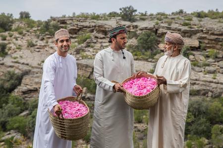 Photo for JABAL AL AKHDAR, OMAN - CIRCA APRIL 2016: three Omani men holding baskets of rose petals - Royalty Free Image