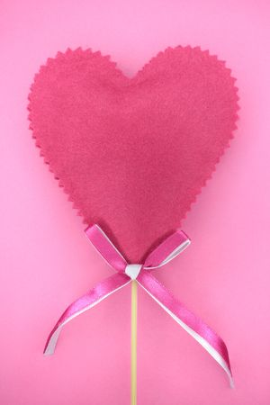 Pink heart on a pink background