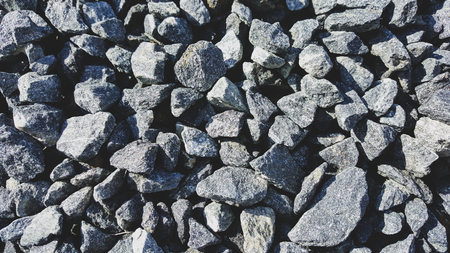 Photo for Gray limestone gravel closeup in sunny day. - Royalty Free Image