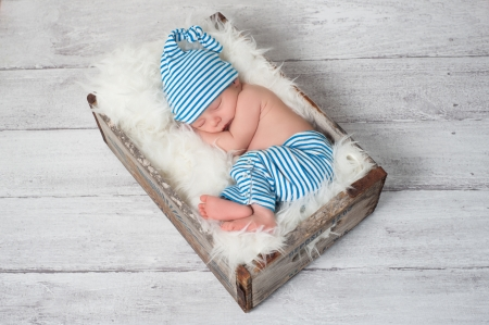 Photo pour Sleeping Newborn Baby Wearing Pajamas and Sleeping Cap - image libre de droit