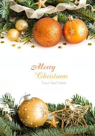 Foto de Golden Christmas ornaments border on white background - Imagen libre de derechos