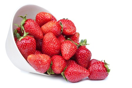 Foto de Red fresh strawberry in a bowl isolated on white background - Imagen libre de derechos