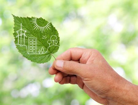 Foto de hand holding Green city concept, cut the leaves of plants - Imagen libre de derechos