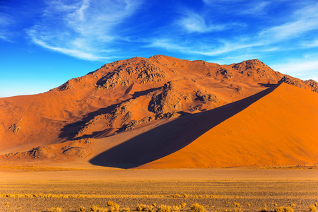 Photo for Orang and yellow dunes of the Namib desert. The concept of extreme and exotic tourism. Namibia, South Africa. Sunset in the desert - Royalty Free Image