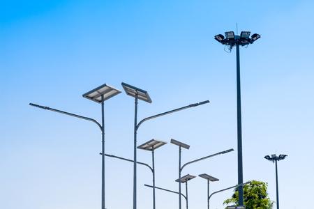 Foto de LED street light with solar cell, electric spot light in blue sky background. Green energy concept. - Imagen libre de derechos
