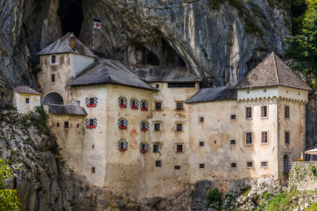 Photo for Renaissance Castle Built Inside Rocky Mountain in Predjama, Slovenia. Famous Tourist Place in Europe. - Royalty Free Image