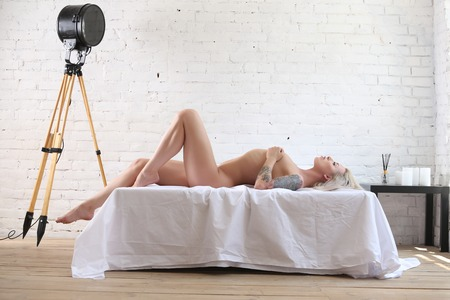 Photo for Nude woman lying on the bed. Photographie retouchee - Royalty Free Image