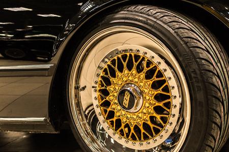 Photo pour BBS logo close up on a chrome golden luxury car rims - image libre de droit