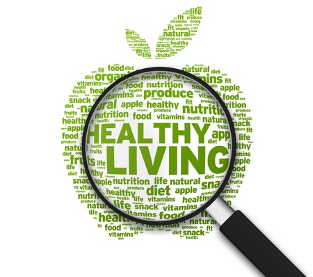 Foto de Magnified Apple with the words Healthy Living on white background. - Imagen libre de derechos