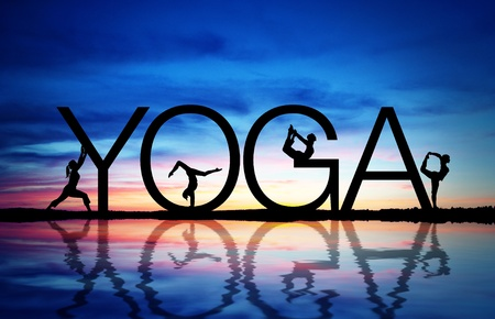 Photo for Sunset with yoga sign and women exercising.  - Royalty Free Image