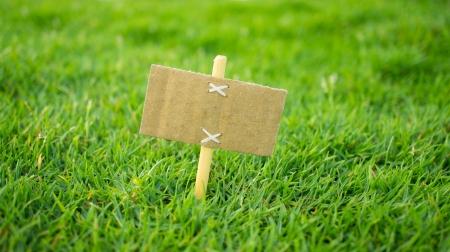 Photo pour A miniature for sale sign on green grass - image libre de droit