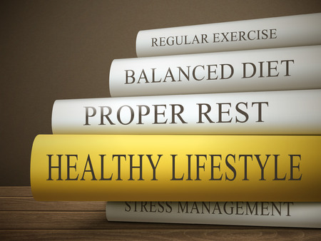 Photo pour book title of healthy lifestyle isolated on a wooden table over dark background - image libre de droit