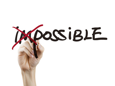 Photo pour hand turning the word impossible into possible over white background - image libre de droit