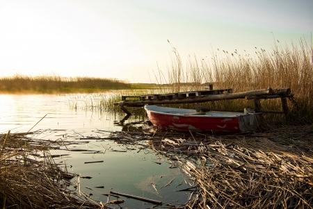 Fishing boat sunset lake