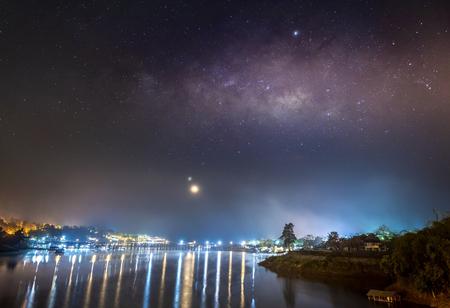 Photo for The Milky Way is above the old wooden bridge (Mon Bridge), Kanchanaburi province, Thailand. - Royalty Free Image