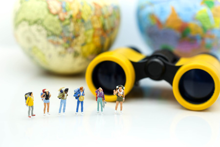 Photo for Miniature people : Traveler team with Binoculars and world map background ,trip traveler concept. - Royalty Free Image