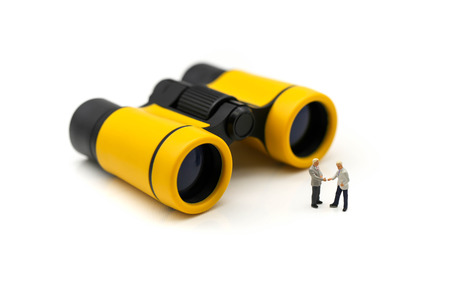 Photo for Miniature people : Businessman standing with binoculars,Choice of the best suited employee, HR, HRM, HRD, job recruiter concepts. - Royalty Free Image