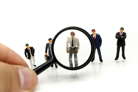 Photo for Miniature people: Magnifying glass focusing on the selected of businessman ,recruitment process, HR, HRM, HRD concepts. - Royalty Free Image