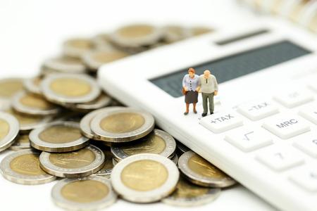 Photo pour Miniature people : Couple oldman standing with Calculator,business,tax concept. - image libre de droit