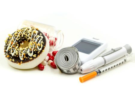Foto per Glucose meter diabetes test and Syringe with measuring tape and drug pill of dessert,Diabetes concept. - Immagine Royalty Free