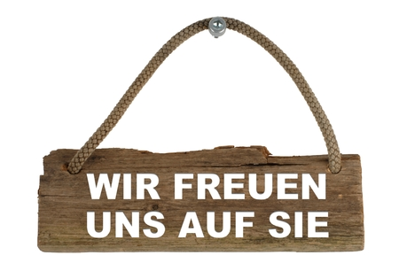 Photo pour Isolated wood board with rope for hanging  we like to meet you - image libre de droit
