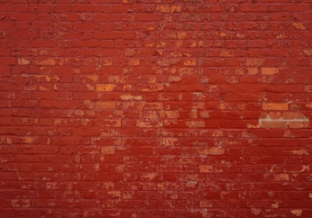 Photo pour Background of an old brick wall with red stones - image libre de droit