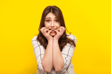 Photo for Scared girl posing on yellow - Royalty Free Image