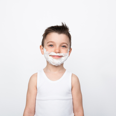 Photo for Content boy in shaving foam - Royalty Free Image