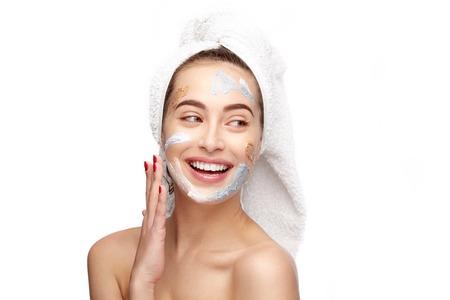 Photo pour Cheerful woman using mask on face - image libre de droit