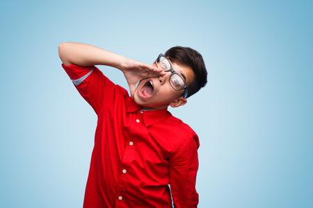 Photo pour Boy shouting loud - image libre de droit