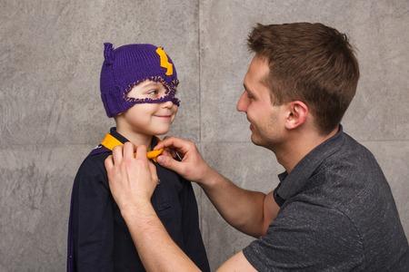 Foto de Father with child in superhero costume - Imagen libre de derechos