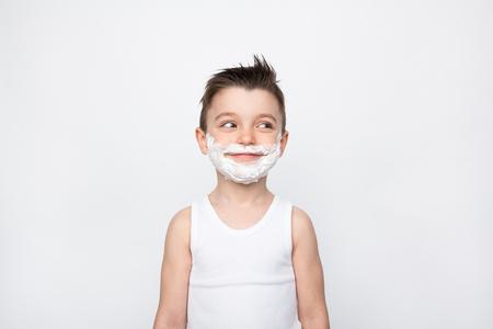 Photo pour Boy with shaving foam on face - image libre de droit