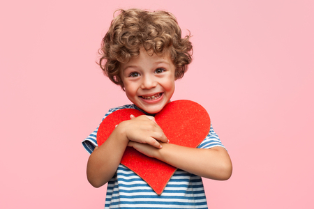 Photo for Charming boy posing with heart - Royalty Free Image