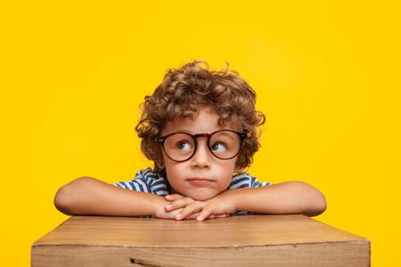 Foto de Pensive charming boy on studio background - Imagen libre de derechos