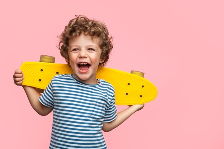 Photo for Cheerful boy with yellow longboard - Royalty Free Image