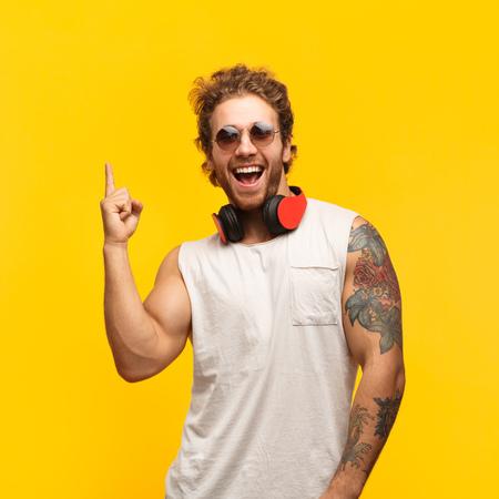 Photo pour Cheerful man pointing up - image libre de droit