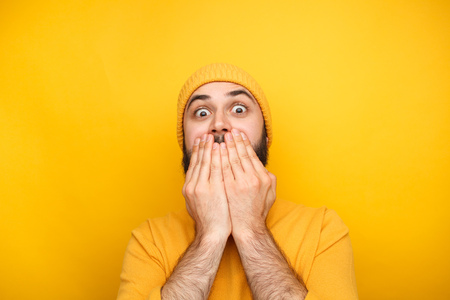 Photo for Frightened man in yellow clothes - Royalty Free Image