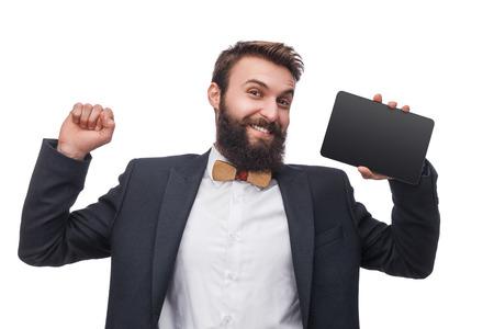 Foto de Man in suit holding tablet in studio - Imagen libre de derechos