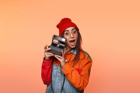 Foto de Young woman with retro camera in studio - Imagen libre de derechos