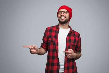 Foto de Man pointing with fingers in studio - Imagen libre de derechos